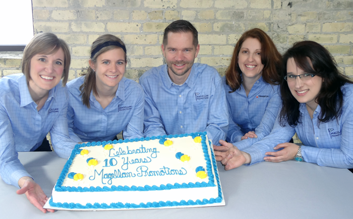 Magellan Promotions Staff with 10 year Anniversary Cake